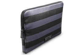 Ben Minkoff Surface Sleeve in a navy and black stripe pattern.