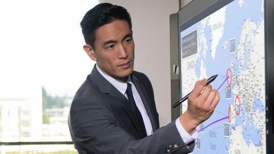 Man using Surface Pen on Microsoft Surface Hub