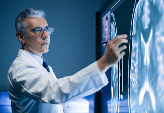 Doctors reviewing X-rays on screen of  Microsoft Surface Hub