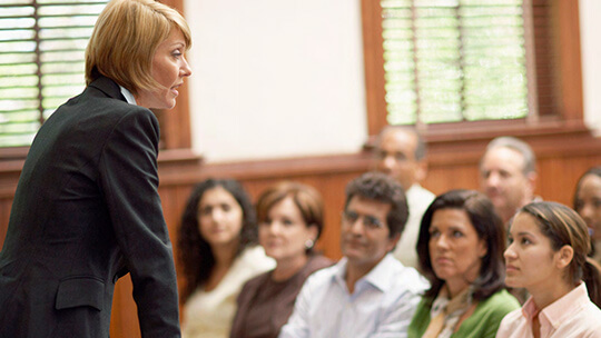 Woman speaking to jury in courtroom