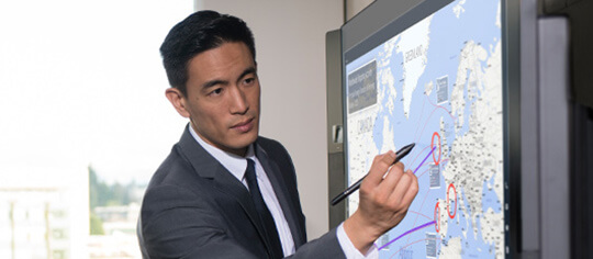 Man using Surface Pen on Microsoft Surface Hub